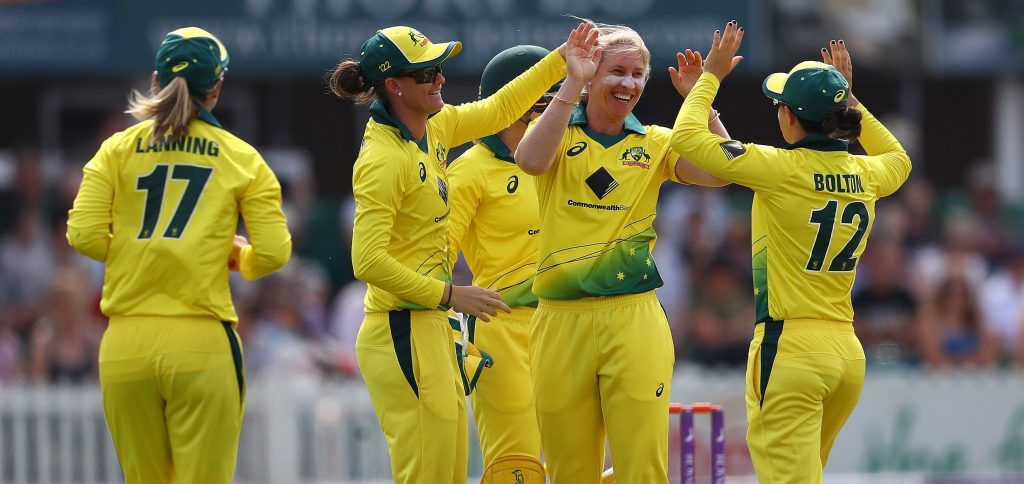 Delissa Kimmince celebrates the wicket with her teammates.