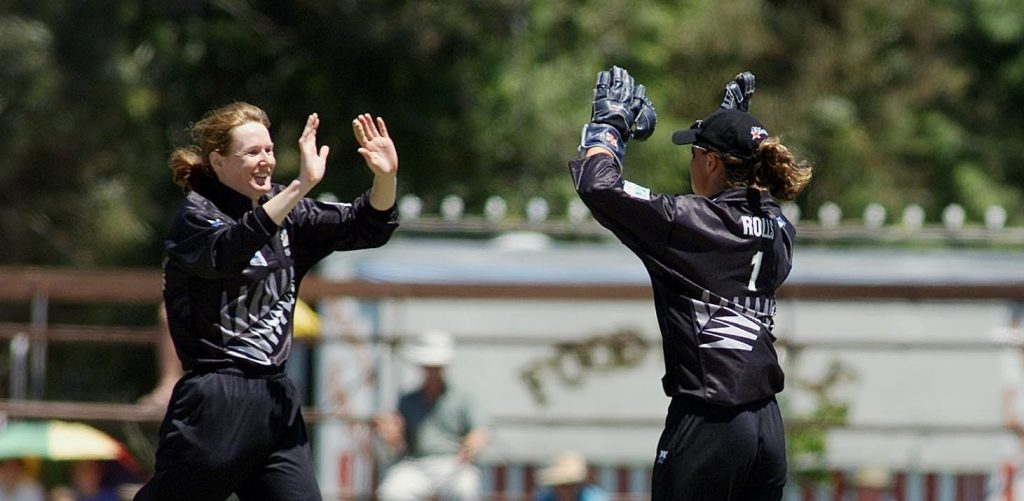 Clare Nicholson (L) and Rebecca Rolls celebrate the fall of a wicket. © Getty Images